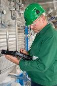 Picture of performing a NEN 3140 test with a tablet